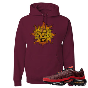 printed on the front of the air max plus sunburst sneaker matching maroon pullover hoodie is the vintage lion head