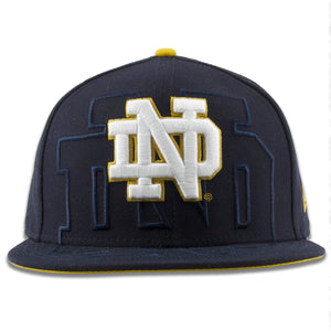 Embroidered on the front of the Notre Dame overspill snapback hat is the Notre Dame logo in white with a gold outline