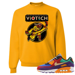 Printed on the front of the Air Max 90 Viotech gold sneaker matching crewneck sweatshirt is the Viotech Rattlesnake Jones logo