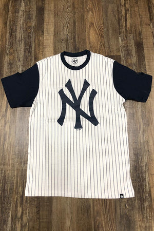 On the front of the New York Yankees Throwback Vintage Pinstripe Tee | Men's Retro Black and White Striped Yankees T-Shirt is a black screenprint Yankees logo and a contrast collar against a cream colored background