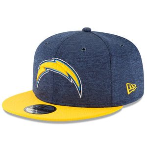 On the front of the 2018 Los Angeles Chargers 9Fifty Snapback hat is the Chargers logo embroidered in yellow, light blue, and white