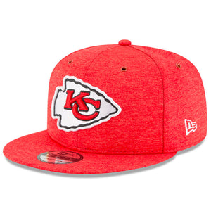 Embroidered on the front of the kansas city chiefs on field 2018 snapback hat is the KC chiefs logo embroidered in red, white, and black