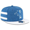 on the right side of the indianapolis colts 2018 on field snapback hat is a white and blue stripped panel