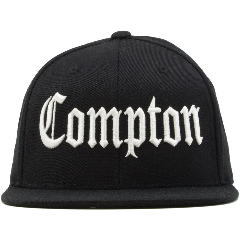 The Straight Outta Compton Classic snapback hat has the word Compton in white thread embroidered on the front of the cap.