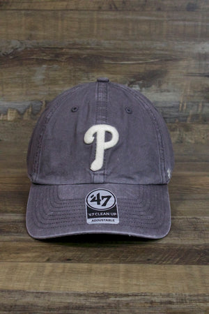 on the front of the Philadelphia Phillies Cinder Gray Dad Hat | Vintage Washed Clean Up Baseball Cap is a cream white current Phillies logo