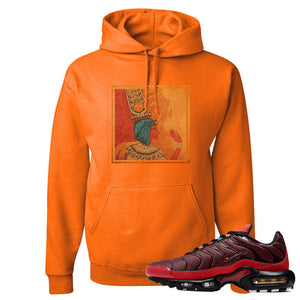 printed on the front of the air max plus sunburst sneaker matching safety orange pullover hoodie is the vintage egyptian logo