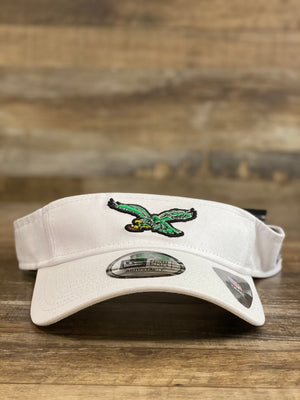 on the front of the Philadelphia Eagles Dugout Redux Retro White Team Visor is a kelly green eagle logo