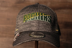 Packers 2020 Training Camp Flexfit | Green Bay Packers 2020 On-Field Grey Training Camp Stretch Fit  the front of this packers hat has the packers name