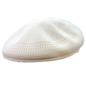 The lightweight kangol natural jeff cap is a cream color