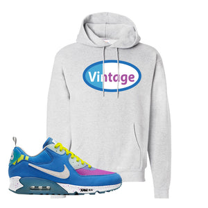 Undefeated x Air Max 90 Pacific Blue Sneaker Ash Pullover Hoodie | Hoodie to match Undefeated x Nike Air Max 90 Pacific Blue Shoes | Vintage Oval