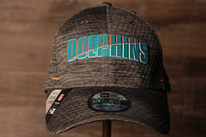 Dolphins 2020 Training Camp Flexfit | Miami Dolphins 2020 On-Field Grey Training Camp Stretch Fit the front of this cap has the dolphins name on it