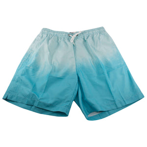 The dip dye ocean blue swim shorts go from light to dark as you go down the leg