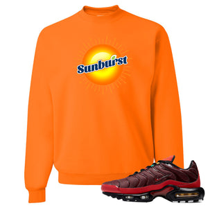 printed on the front of the air max plus sunburst sneaker matching safety orange crewneck sweatshirt is the sunburst soda logo