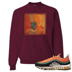 Printed on the front of the Air Max 97 Sunburst maroon sneaker matching crewneck sweatshirt is the Vintage egyptian logo