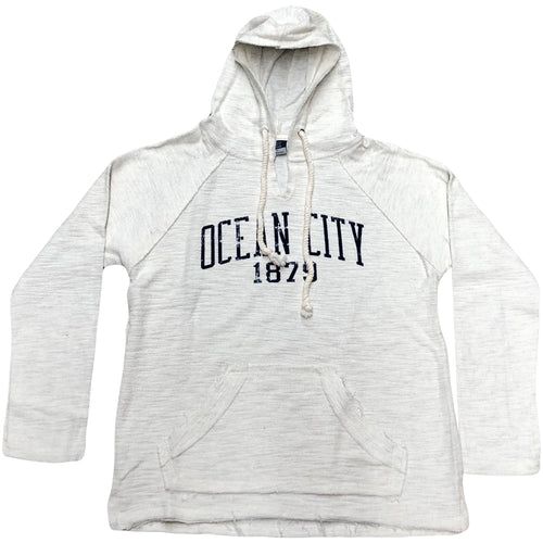 The men's oatmeal ocean city 1879 hoodie is an oatmeal color with the city ocean city printed in navy blue above the year 1879