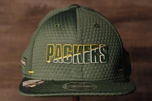 Packers 2020 Training Camp Snapback Hat | Green Bay Packers 2020 On-Field Green Training Camp Snap Cap the front of this packers hat has the packers name with a flat brim