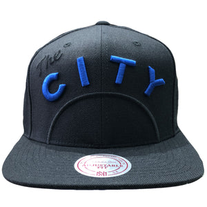"Embroidered on the front of the Golden State Warriors snapback hat is the vintage Warriors ""The City"" logo embroidered in blue and black"