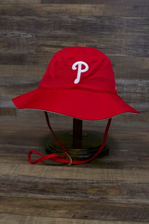 on the front of the Philadelphia Phillies Panama Pail Bucket Hat | Red Athletic Fabric Wide Brim Phils Training Bucket Hat is the current white Phillies P logo