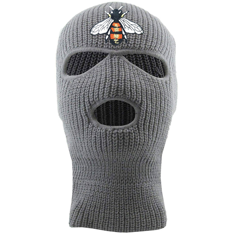Embroidered on the front of the bumblebee light gray ski mask is the bumble bee logo embroidered in red, white, black, and gold