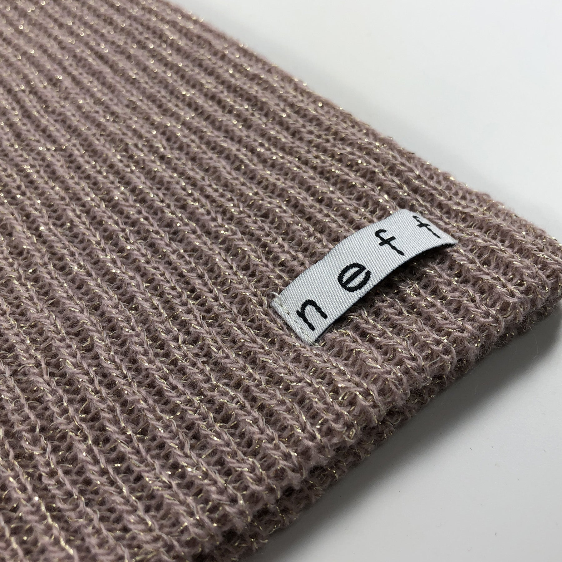 5c219688fd1 ... on the bottom left corner of the neff daily rose gold metallic knit  beanie is the