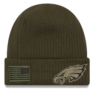 on the front of the kid's sized Philadelphia Eagles 2018 Salut to Service On Field knit beanie is the Philadelphia Eagles tonal military logo