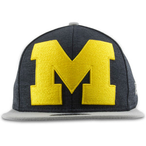 Embroidered on the front of the XL Michigan Two-Tone snapback hat is the Michigan logo in yellow