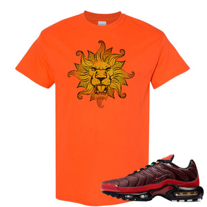 printed on the front of the air max plus sunburst sneaker matching orange tee shirt is the vintage lion head