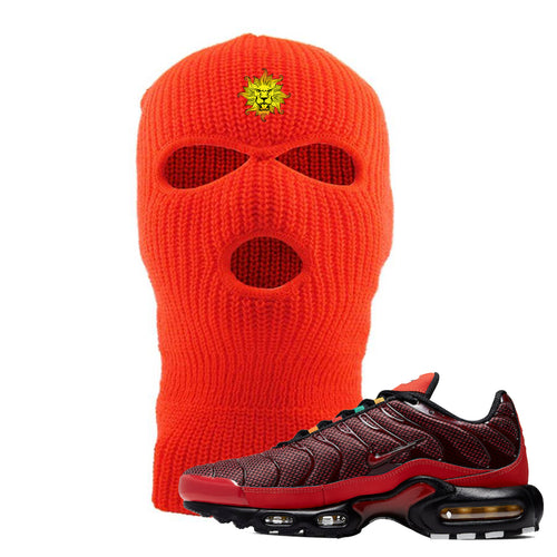 Embroidered on the front of the air max plus sunburst sneaker matching safety orange ski mask is the vintage lion head l