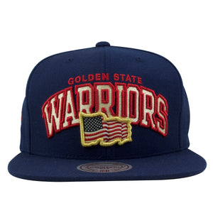 Embroidered on the front of the Golden State Warriors snapback hat is the Warriors lettering arched over the USA flag embroidered in red, white, and blue