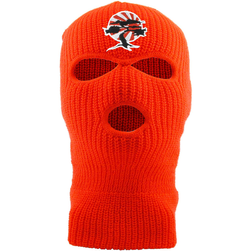 Embroidered on the front of the Foot Clan Bonsai Tree safety orange ski mask is the Foot Clan Bonsai Tree Rising Sun logo