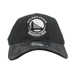 embroidered on the front of the golden state warriors black on black camouflage dad hat is a warriors logo embroidered in white