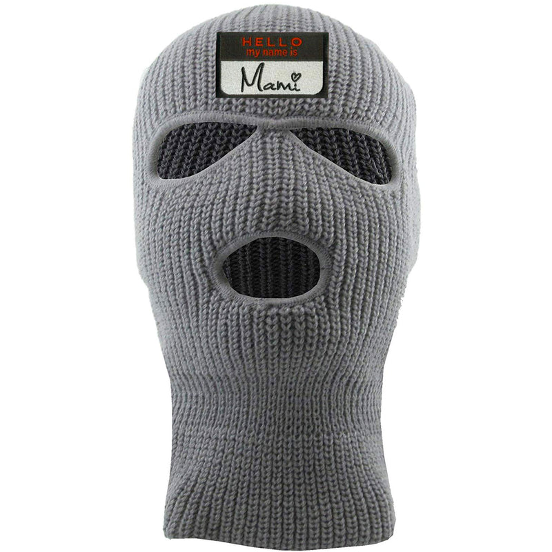 Embroidered on the front of the light gray hello my name is mami ski mask is the hello my name is mami logo embroidered in black white and red