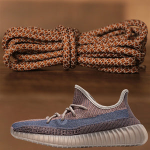 The reflective brown yeezy matching sneaker shoe laces alongside the Yeezy Boost 350 V2 Fade