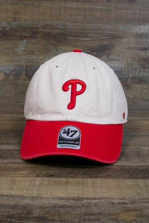 on the front of the Philadelphia Phillies Dad Hat | Vintage Look P Logo Bone and Red Baseball Cap is the current Phillies P logo and a red curved brim