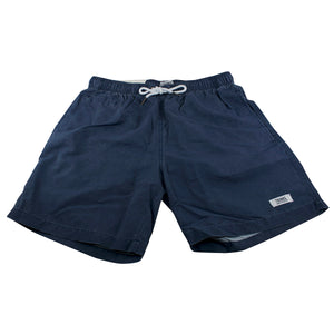 The dark blue swim shorts have side pockets