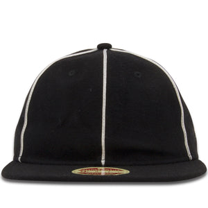 The Philadelphia Phillies 1903 Vintage 9Fifty Snapback Hat is made up of a black wool-like material with vertical white stripes running along the divisions of the cap panels