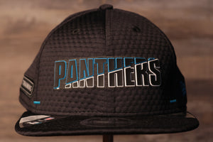 Panthers 2020 Training Camp Snapback Hat | Carolina Panthers 2020 On-Field Black Training Camp Snap Cap the front of this panthers training camp snapback has the panthers name on the front