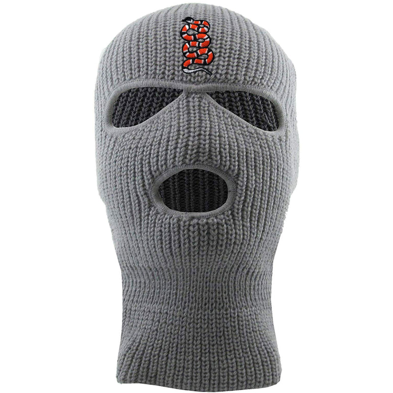 Embroidered on the forehead of the light gray coiled snake ski mask is the snake logo in red, white, and black