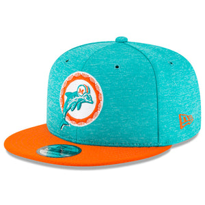 Embroidered on the front of the vintage miami dolphins on field snapback hat is the historic throwback miami dolphins logo embroidered in white, teal, and orange