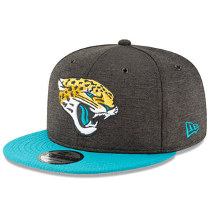 Embroidered on the front of the 2018 on field Jacksonville Jaguars snapback hat is the Jacksonville Jaguars logo embroidered in yellow, black, white, and teal