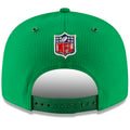 on the back of the 2018 On Field New York Jets Sideline Snapback Hat is a green adjustable snap below the NFL shield