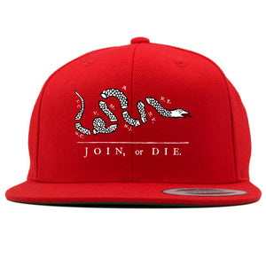 on the front of the join or die red snapback hat is the join or die logo embroidered in white and black
