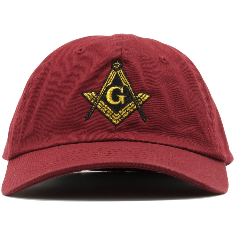 The Free Masons Illuminati Dad Hat has the Free Mason logo embroidered on the front in metallic gold and black.