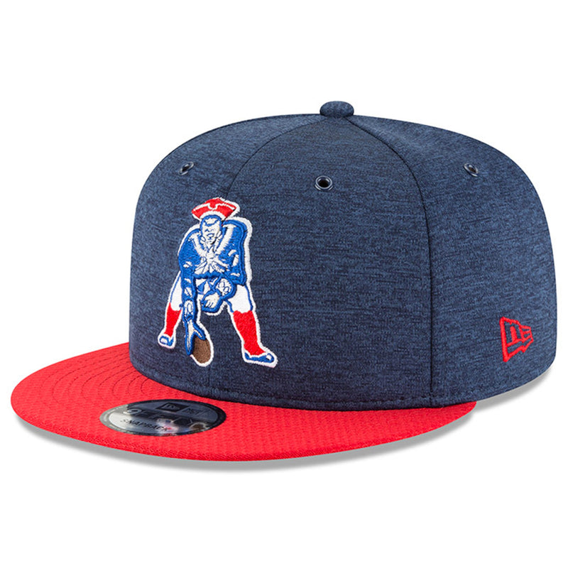 Embroidered on the front of the 2018 New England Patriots Throwback Retro Snapback hat is the vintage New England Patriots logo embroidered in blue, white, and red