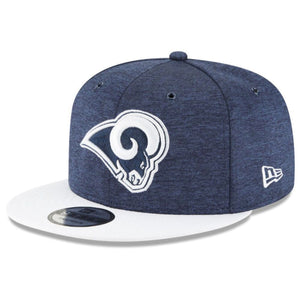 Embroidered on the front of the 2018 Los Angeles Rams On Field 9Fifty Snapback Hat is the Los Angeles Rams logo embroidered in navy blue and white