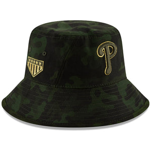 Embroidered on the right side of the Philadelphia Phillies 2019 Memorial Day Camouflage bucket hat is the 5 star shield logo embroidered in metallic gold and military green