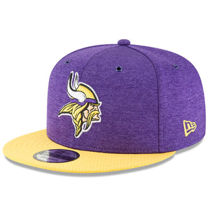 Embroidered on the front of the Minnesota Vikings on field sideline 2018 new era 9fifty snapback hat is the Minnesota Vikings logo in yellow, white, and purple