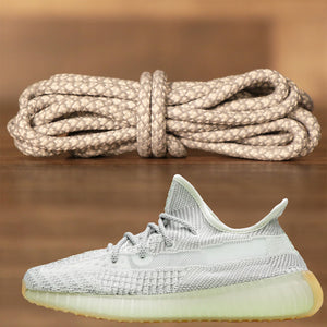 The light gray yeezy rope yeezy matching shoe laces next to the Yeezy Boost 350 V2 Yeshaya