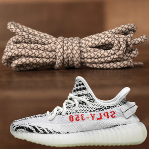 The reflective yeezy matching rope white and gray sneaker shoe laces alongside the Yeezy 350 V2 Zebra