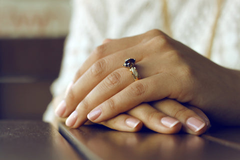 A pair of hands with a wedding ring.